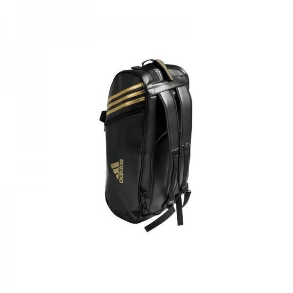 694e4aff7b Sac de sport noir et or Adidas convertible en sac à dos avec logo judo.